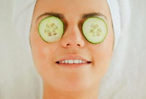 getty_rf_photo_of_woman_having_cucumber_facial